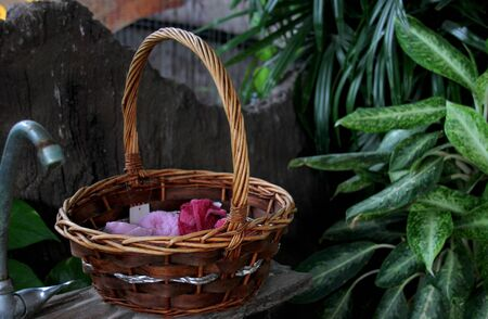 handkerchief and hand towel in wood basket near wooden washbasin