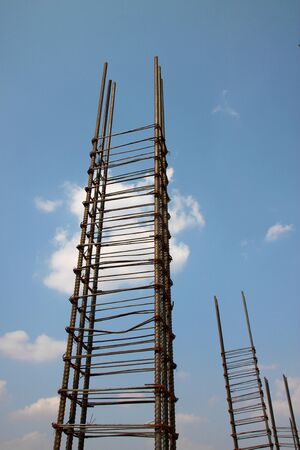 metal post: metal foundation post at building site against the sky