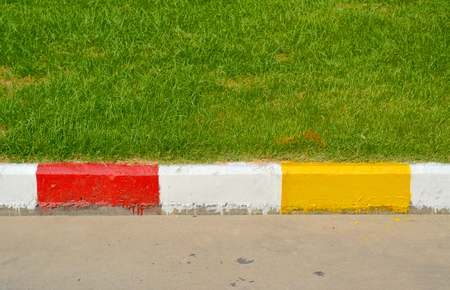 exemplary: exemplary warning sign of red and white and yellow color on road
