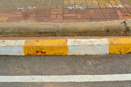 exemplary: exemplary warning sign of white and yellow color on road