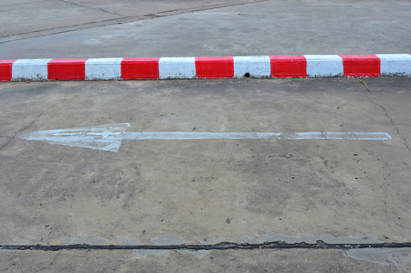 exemplary: exemplary warning sign of red and white color on road