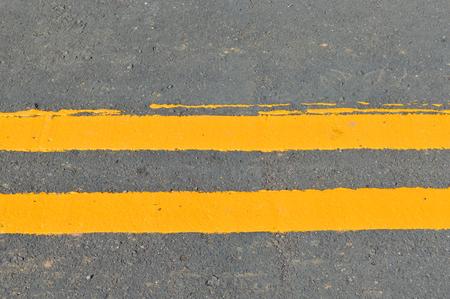 exemplary: exemplary yellow warning sign on asphalt road