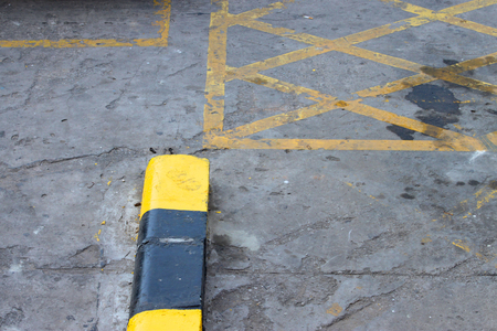 exemplary: exemplary warning sign of black and yellow color on road