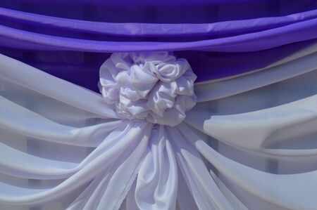art and technique of clothes bind down and pleating in ceremony place decoration handwork Stock Photo