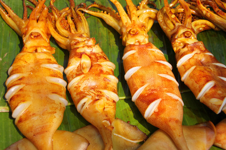 grilled squids on banana leaf