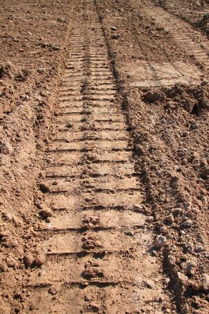 loamy: tractor track on sandy soil at road construction site Stock Photo