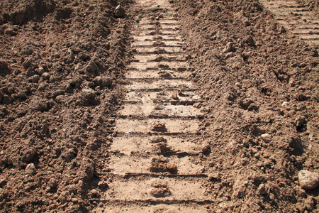 tractor track on sandy soil at road construction site Banco de Imagens - 77534737