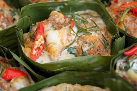 steamed fish with curry paste in banana leaf container vessel