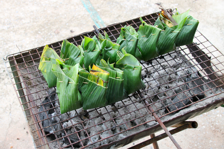 Thai grilled curry fishes wrapped in banana leaf Stock Photo
