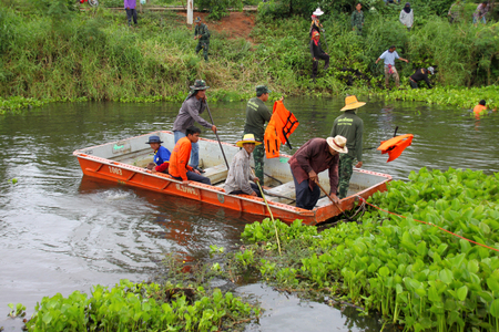 CHIANG YUEN, MAHASARAKHAM - JUNE 9 : Sanitation people are working and try to remove water hyacinth from local canal on June 9, 2017 in Chiang Yuen, Mahasarakham, Thailand.