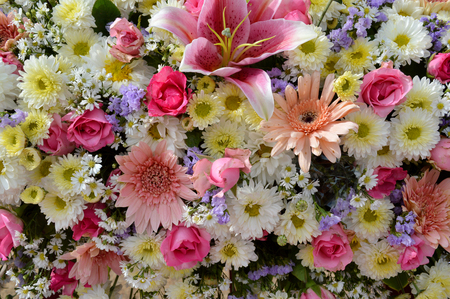 mixed flowers in funeral ceremony wreath Stock Photo
