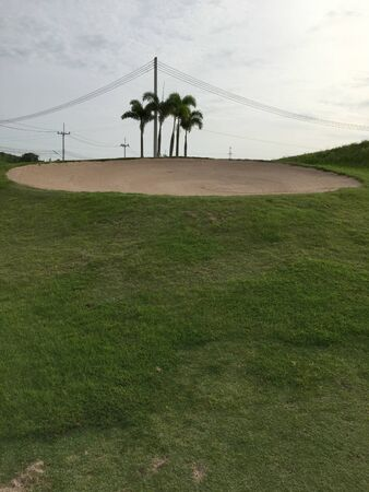 sand and rough green grass from tropical golf ground
