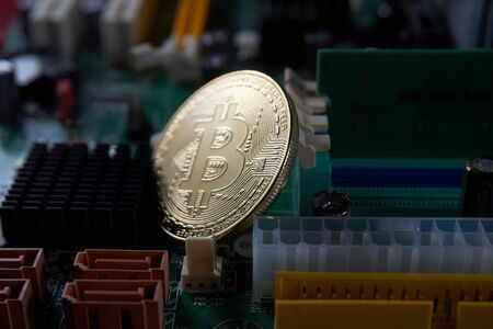 Bitcoin on computer motherboard Stock Photo
