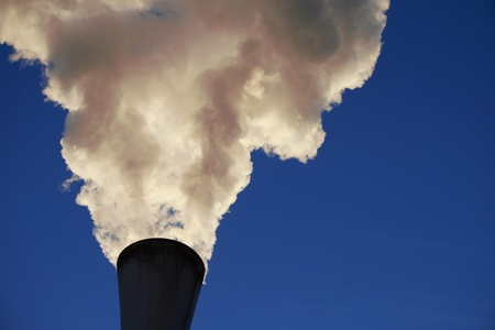White smoke coming out of industrial chimney with blue sky background. Air pollution, greenhouse effect and global warming problem concept. Reklamní fotografie