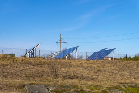 Solar Energy Farm with rows of large photovoltaic panels converting the solar energy of the son into electricity as a source of sustainable or renewable power using natural resources
