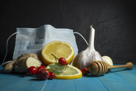 Natural remedies for cold and flu season with fresh root ginger, lemon, garlic and rose hips Reklamní fotografie