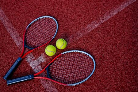 Top view tennis scene with ball, racquet and hard court surface corner line 版權商用圖片