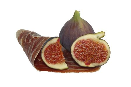 Dry cured ham and whole and sliced figs isolated on white background Stock Photo