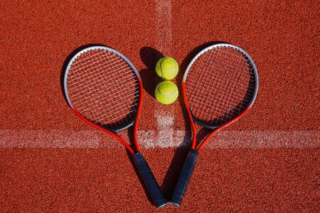 Top view tennis scene with balls, racquets and hard court surface corner line Banco de Imagens