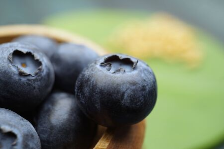 Macro shot of fresh ripe blueberry in wooden container