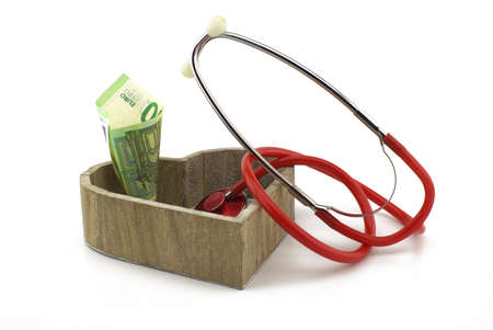 Concept of healthcare and medical costs with stethoscope and euro banknotes money with copy space over white background