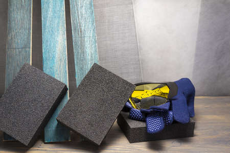 Various grinding tools - abrasive sponge, safety gloves and glasses, renovation, safety and health at work concept 版權商用圖片