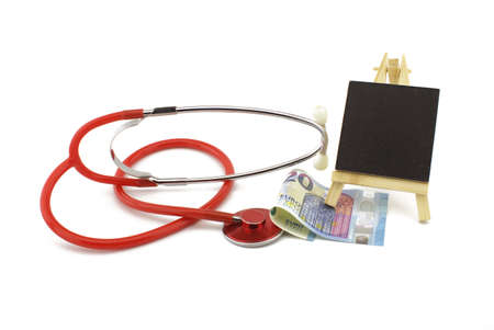 Stethoscope with euro banknotes money with copyspace over white in a concept of healthcare and medical costs