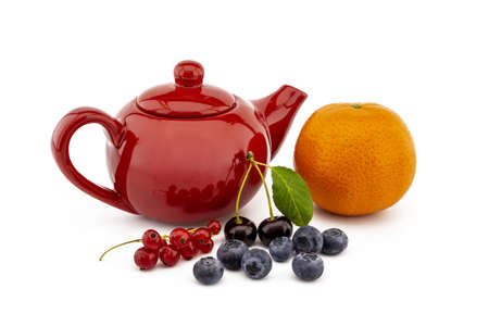 Colorful red teapot and assorted berries including blueberries, cherries, red currants and orange over white in a concept of fruit tea 版權商用圖片