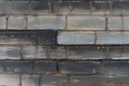 Abstract white, black and gray painted brick wall as background, texture