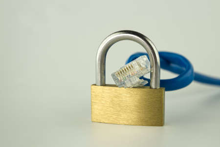 Internet security and network protection concept, padlock and network cable on gray 스톡 콘텐츠