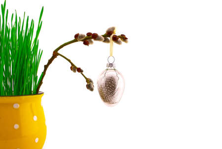 Minimalistic style Easter card with wheat seedlings growing from yellow cup and willow branch with decorations. Happy Easter card concept with free copy space for text