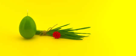Minimalistic style Easter banner with egg shaped candle and bundle of wheat seedlings tied with linen twine on yellow background with free copy space for your text 스톡 콘텐츠
