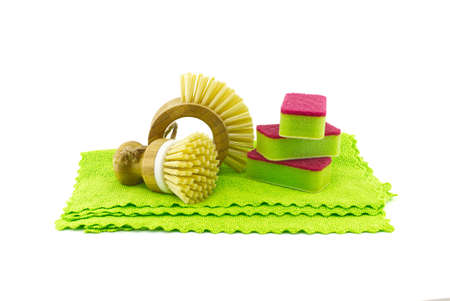 Multicolored cleaning sponges and dish brushes on microfiber cloth isolated on a white background. House cleaning products
