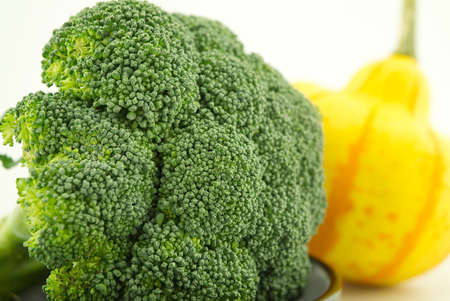 Fresh broccoli in close up on kitchen table, selective focus