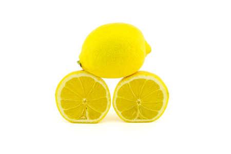 Whole and halved ripe lemon fruit isolated on white background