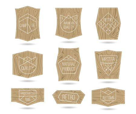 Set of retro vintage badges quality in thin line style on a textured wood board