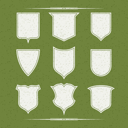 mottling: Design elements forms shields, white on a green background with texture