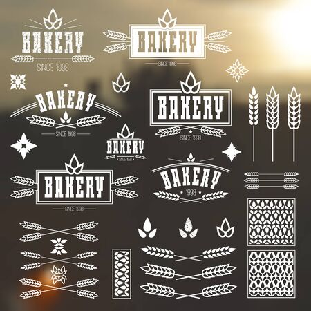 Design elements and for bakery. White print on a blurred background