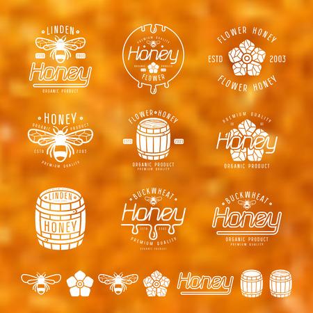 Set of honey labels, badges and design elements. White print on blurred background Illustration