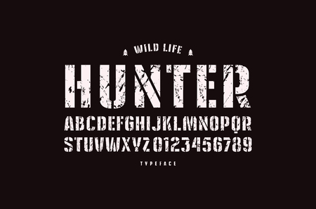 Original stencil-plate sans serif font. Bold face. Letters and numbers with rough texture for logo and emblem design. White print on black background Фото со стока - 97223705