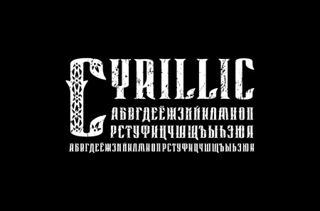 Decorative serif font in retro style. Cyrillic initial letters with rough texture for label design. White print on black background