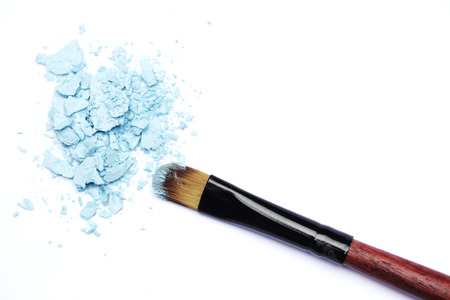 grooming product: Pastel blue eyeshadows and brush Stock Photo