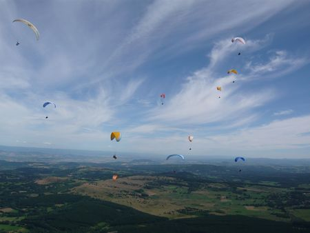 croud: Many paragliders in Auvergne in France over the Puy de Dome