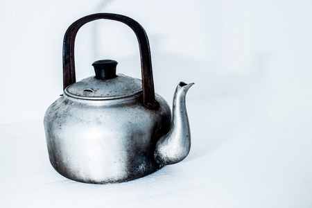 stovetop: old kettle metallic