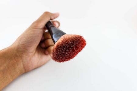 grooming product: Make-up Brush hold on white Stock Photo