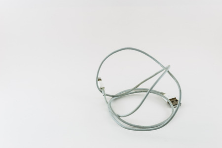 cable tangle: tangle charging cable on white