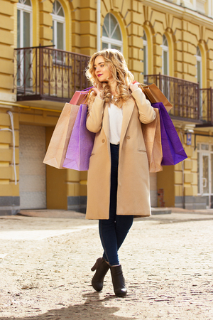 shoppings: Stylish, beautiful blonde hair smiling girl with shoppings. Happy shopping.