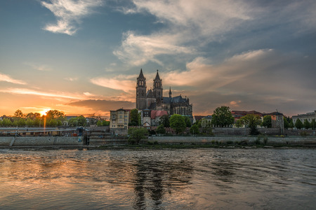 Cathedral of Magdeburg and the river Elbe at sundown, summer 2013 photo