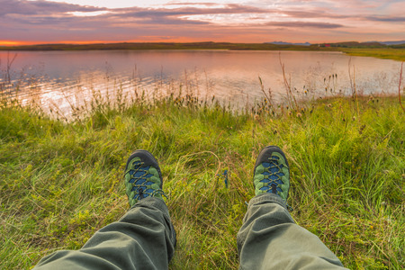 hiking boots: Hiking boots and tundra sunset at Iceland, summer time, 2016