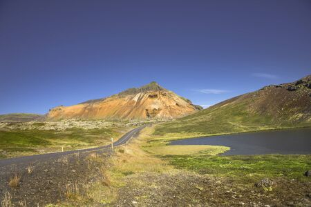 Isolated road and mountains at Iceland, summer time, 2016